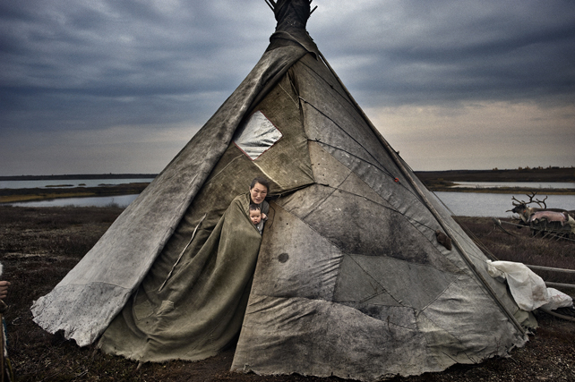 ©Yuri Kozyrev / NOOR From the series: Yamal Peninsula Caption:Three Nenet families live on the tundra in reindeer-skin tents. The group has around 600 reindeer.